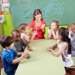 teacher telling a story to the children