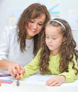 teacher teaching the girl on how to draw
