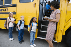 children ready to ride a school bus
